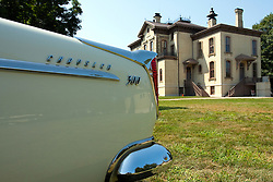 7 August 2010: Chrysler 300 rear fin and David Davis Mansion. Antique Car show, David Davis Mansion, Bloomington Illinois