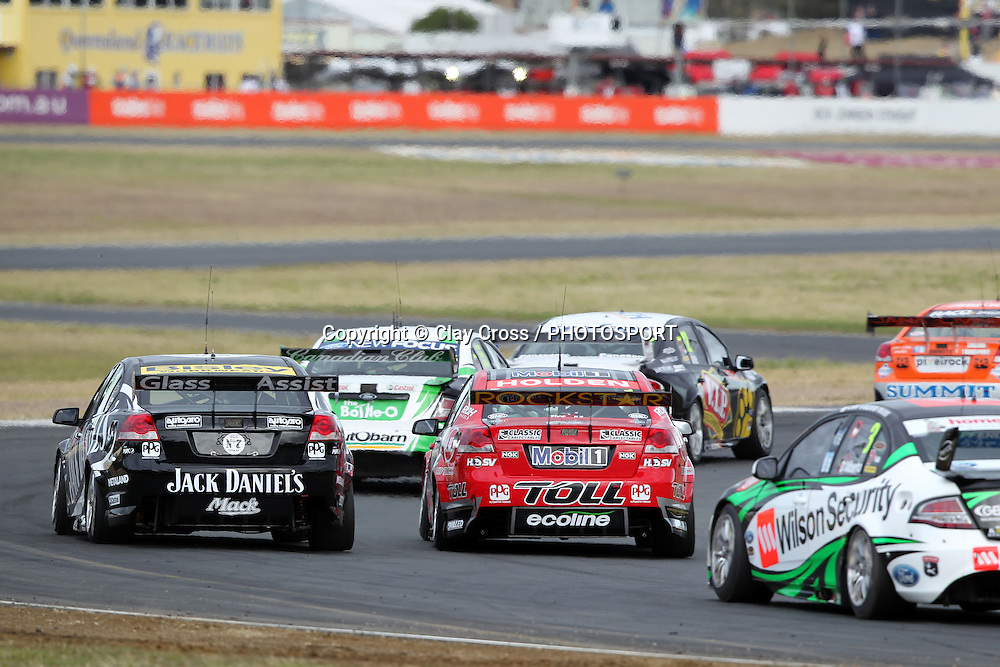 Garth Tander (Toll Holden Racing Team) leads Rick Kelly. Coates Hire Ipswich 300 ~ Race 18 of the 2011 V8 Supercar Championship Series. Queensland Raceway on Sunday 21 August 2011. Photo © Clay Cross / PHOTOSPORT