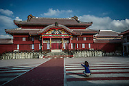 Shuri Castle in Naha: Echoes of the Forbidden City in Beijing in color and gold leaf, except for the distinctly Japanese arch over the front entryway.  <br /> <br /> Okinawa, then known as the Ryukyu Kingdom, was a tributary state of the Ming Dynasty of China until the Satsuma Domain of Southern Kyushu conquered it and brought it within the Japanese fold.<br /> <br /> There are some in China who believe that Okinawa should be returned to China, though it was an independent state during the Ming Dynasty and its language and culture closer to that of Japan than China.