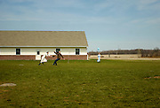 Students at the Owasco Lake Mennonite School play softball during their afternoon recess. <br /> Fleming, NY, April 2009.