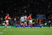 Wales players celebrate their historic win over England at the final whistle of the Rugby World Cup Pool A match between England and Wales at Twickenham, Richmond, United Kingdom on 26 September 2015. Photo by David Charbit.