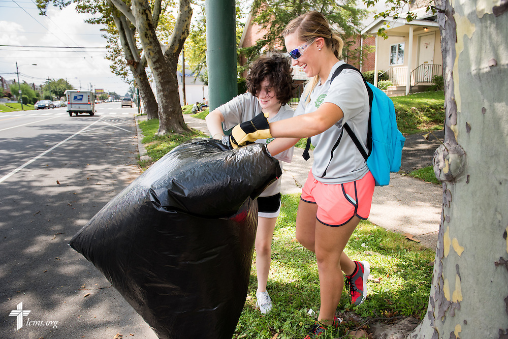 Abigail Konig and Darrian Doederlein (foreground) in the 2014 Youth Corps pilot project clean the grounds at Shepherd of the City Lutheran Church on Wednesday, August 13, 2014, in Philadelphia, Pa. LCMS Communications/Erik M. Lunsford