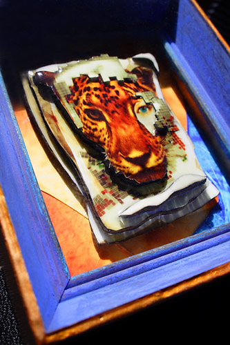 title: &quot;Little Leopard&quot;<br /> <br /> dimensions: 5&quot;x4&quot;x2&quot;<br /> <br /> materials: montage, alchemic photography &amp; mixed media encased in glass frame<br /> <br /> +created &amp; designed photo sculpture by Star Nigro exclusively<br /> <br /> www.StarNigro.com