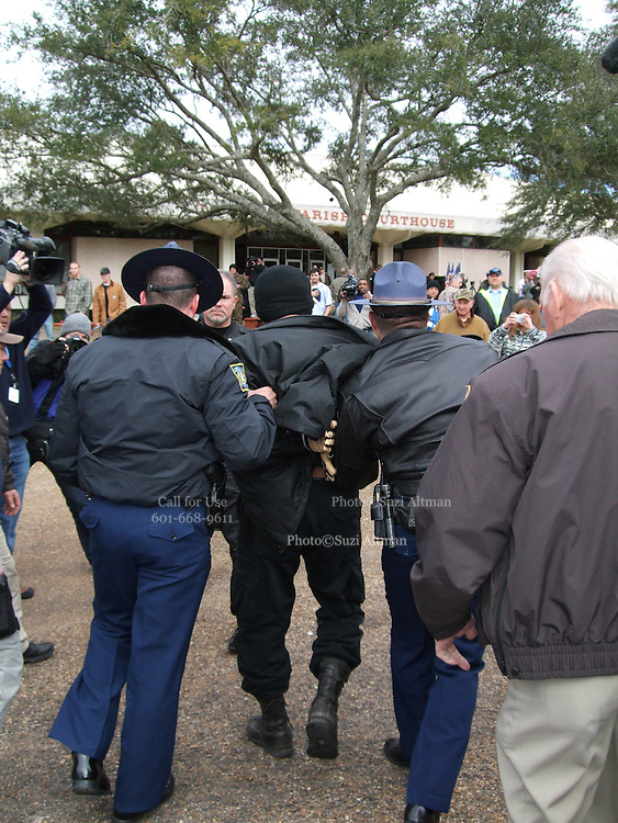 Black Panther, William Winchester Jr. of New Orleans, is arrested outside the LaSalle County Courthouse, and booked on the charge of battery on a police officer during a clash with the police. with A group of protesters march to Jena High School on the Martin Luther King Jr. holiday in Jena, La., Monday, Jan. 21, 2008. The protest was organized by the self-described 'pro-majority' Nationalist Movement of Learned, Mississippi, lead by Richard Barrett, and was being held in opposition to the six black teenagers who were arrested in the beating of a white classmate in December 2006, and the King holiday. The protest drew about 50 participants and 100 counter-demonstrators to Jena.(Photo/© Suzi Altman)