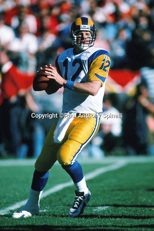 St. Louis Rams quarterback Chris Miller (12) drops back to pass during the NFL football game against the San Francisco 49ers on Nov. 26, 1995 in San Francisco. The 49ers won the game 41-13. (©Paul Anthony Spinelli)