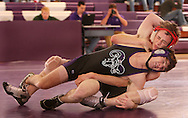 Simpson's Casey Miller tries to control Cornell's Micky Spiwak (front) in the 125 lb weight class match between Simpson College and Cornell College at the Small Multi-Sport Center in Mount Vernon on Wednesday November 19, 2008. Spiwak won a major decision and Cornell won the meet 35-10.