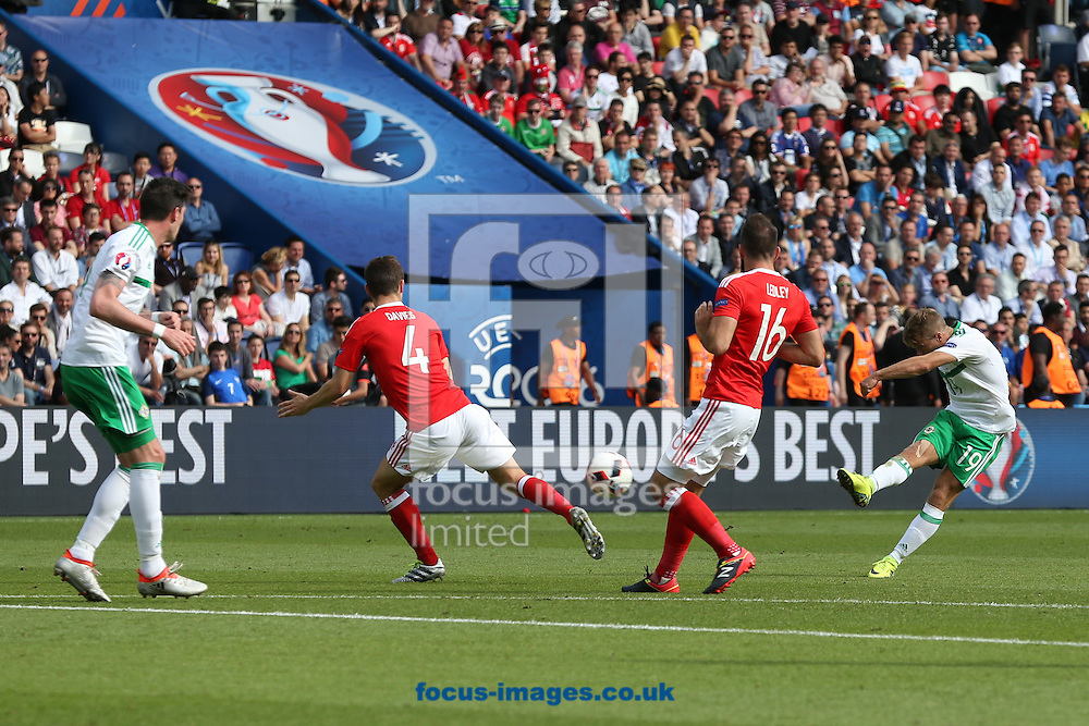 Jamie Ward of Northern Ireland has a shot on goal during the UEFA Euro 2016 match at Parc des Princes, Paris<br /> Picture by Paul Chesterton/Focus Images Ltd +44 7904 640267<br /> 25/06/2016