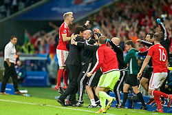 LILLE, FRANCE - Friday, July 1, 2016: Wales' Aaron Ramsey celebrates the 3-1 victory over Belgium with Wales manager Chris Coleman and Dr Ian Mitchell after the UEFA Euro 2016 Championship Quarter-Final match at the Stade Pierre Mauroy. (Pic by Paul Greenwood/Propaganda)