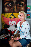 "Artist and photographer, Ismary Gonzalez Cabrera, 48, is photographed in her studio in Old Havana. ""My parents were devoted to the revolution and were quite absent so I had a lonely childhood,"" she says. She has one child, Pablo, and tries to share her experiences through her art. ""I'm so happy that I have been able to make art my career. I know many artists struggle to live off their art and to me it is my greatest achievement,"" she adds. She dreams of traveling to other countries and experiencing other cultures but knows that isn't realistic at the moment.  Of Cuban women, she says, ""We are warriors. Like everyone, we need love, we need family and we need work."""