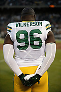 Green Bay Packers defensive end Muhammad Wilkerson (96) looks on from the sideline during the playing of the National Anthem before the 2018 NFL preseason week 3 football game against the Oakland Raiders on Friday, Aug. 24, 2018 in Oakland, Calif. The Raiders won the game 13-6. (©Paul Anthony Spinelli)