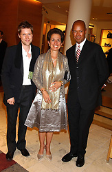 "Left to right, CHRISTOPHER BAILEY, ROSE MARIE BRAVO and MICHAEL ROBERTS  at a party hosted by Christopher Bailey to celebrate the launch of ""The Snippy World of New Yorker Fashion Artist Michael Roberts"" held at Burberry, 21-23 New Bond Street, London on 20th September 2005.<br />