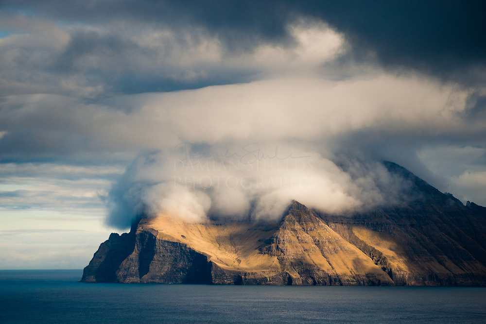 I loved the way the cloud formations were sitting over the peaks, reminding me of a gigantic steam engine. Villingadalsfjall mountain is at the most northern reach of the Islands and also feature the Enniberg cliff, which at 750 m is the second-highest sea-cliff in Europe.