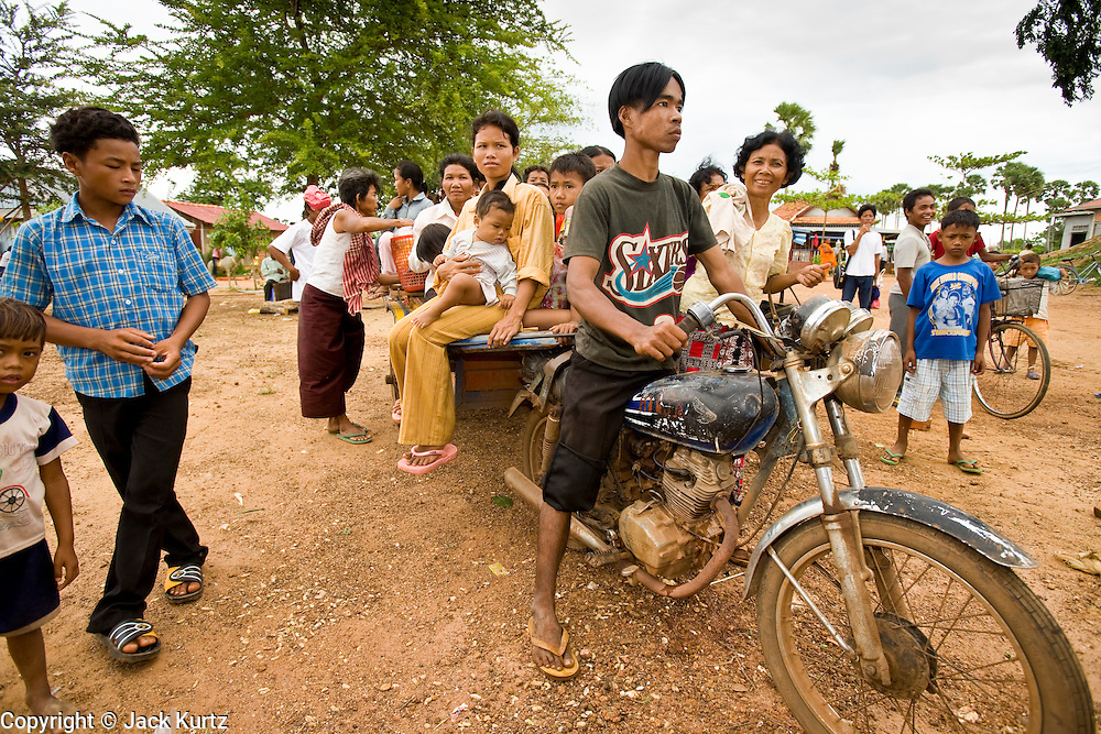02 JULY 2006 - UDONG, CAMBODIA: A tuk-tuk hauls passengers near Udong, Cambodia. Tuk-tuks are trailers attached to motorcycles and are commonly used to haul freight and passengers in Southeast Asia. They can be small and relatively ornate and cater primarily to tourists or large and utilitarian and used to haul freight or passengers depending on the need. In rural areas of Cambodia, the utilitarian ones are more common.  Photo by Jack Kurtz / ZUMA Press