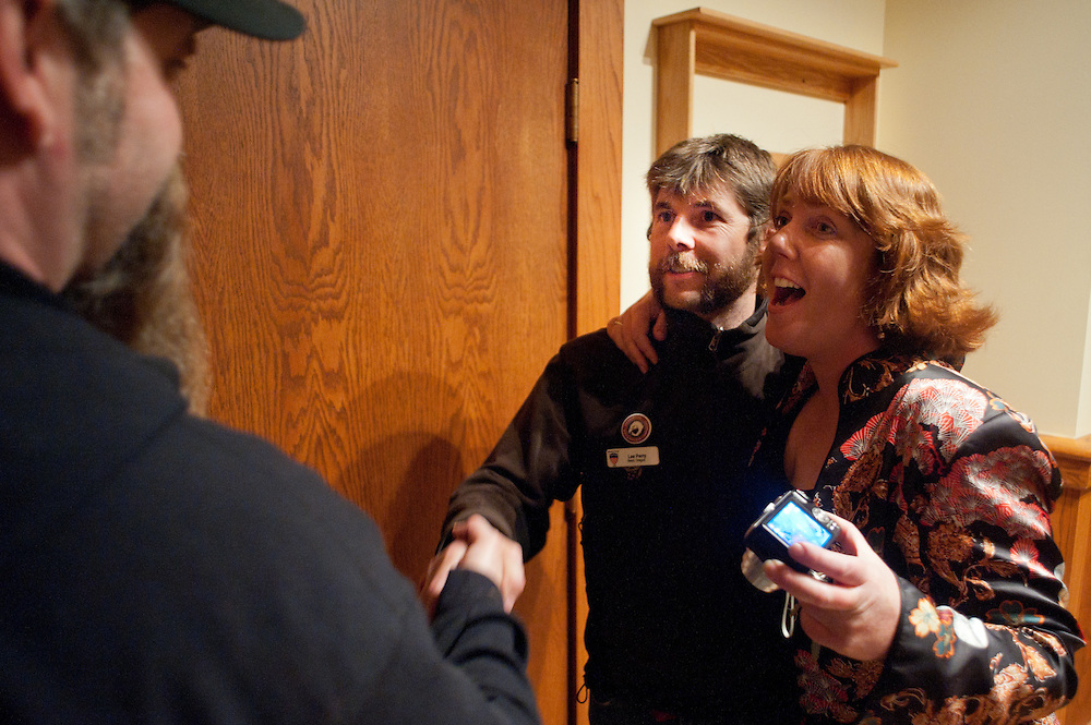 Lee Perry, center, and Sandy Henderson greet entrants during the introductory gala at the Old Stone Church on Friday, June 4 during the 2010 Beard Team USA National Beard and Mustache Championships in Bend, Oregon.