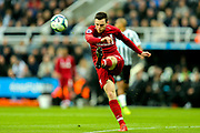 Andrew Robertson (#26) of Liverpool clears the ball during the Premier League match between Newcastle United and Liverpool at St. James's Park, Newcastle, England on 4 May 2019.