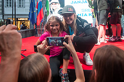 Janja Garnbret posing for a photo with young fan during PZS reception of Slovenian national climbing team after IFSC Climbing World Championships in Hachioji (JPN) 2019, on August 23, 2019 at Ministry of Education, Science and Sport, Ljubljana, Slovenia. Photo by Grega Valancic / Sportida
