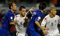 Photo: Richard Lane.<br />Croatia v England. UEFA European Championships 2008 Qualifying. 11/10/2006. <br />England's John Terry battles with Croatia's Robert Kovac (lt) and Vedran Corluka.