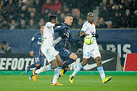 FOOTBALL - FRENCH CHAMPIONSHIP 2012/2013 - L1 - PARIS SAINT GERMAIN v OLYMPIQUE MARSEILLE - 24/02/2013 - PHOTO JEAN MARIE HERVIO / REGAMEDIA / DPPI - JEREMY MENEZ (PSG) / NICOLAS NKOULOU (OM)