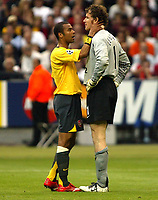 Photo: Chris Ratcliffe.<br /> Arsenal v Barcelona. UEFA Champions League Final. 17/05/2006.<br /> Jens Lehmann is consolded by Ashley Cole