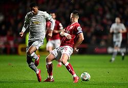 Bailey Wright of Bristol City tackles  Marcus Rashford of Manchester United  - Mandatory by-line: Joe Meredith/JMP - 20/12/2017 - FOOTBALL - Ashton Gate Stadium - Bristol, England - Bristol City v Manchester United - Carabao Cup Quarter Final
