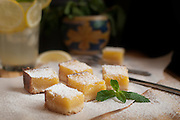 Lemon Bars dusted with Powdered Sugar and Lemonade by Rodney Bedsole, a food photographer based in Nashville and New York City.