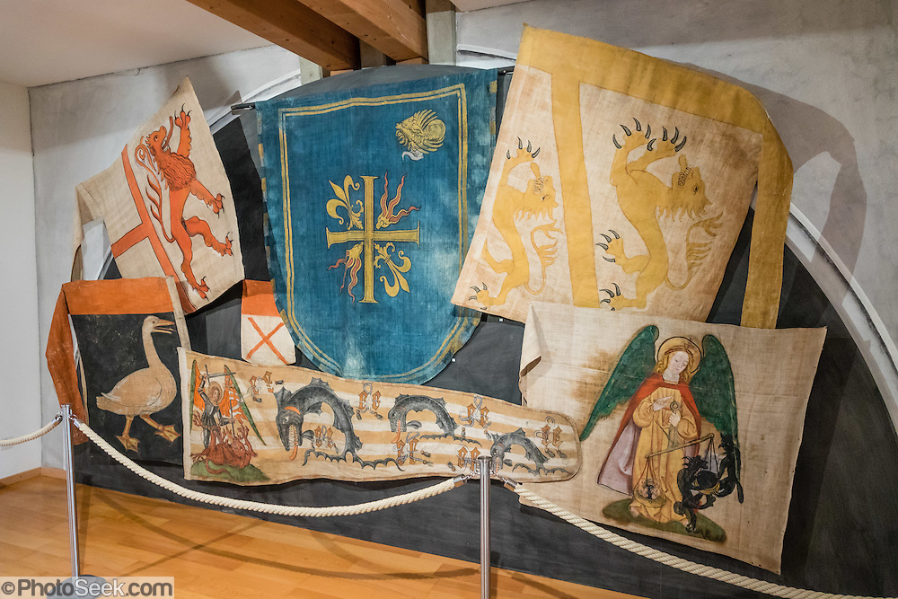 "In Appenzell Museum, these flags are 1640-1663 replicas (by painter Hans Bildstein) of flags captured from the 1403-1407 Appenzell Wars of Liberation through the wars against the Turks around 1600, which were kept in the parish church until 1822 as offerings to God and St. Mauritius. Appenzell Museum, which is in the town hall, shows a cross section of the Swiss Canton's history and culture. Appenzell village is in Appenzell Innerrhoden, Switzerland's most traditional and smallest-population canton (second smallest by area). The canton of Appenzell divided itself into an ""inner"" and ""outer"" half (Rhoden) as a consequence of the Reformation in Switzerland in 1597: Appenzell Innerrhoden (Catholic) and Appenzell Ausserrhoden (Protestant)."