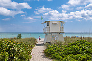 Sandy beach walkway and lifeguard station at Hobe Sound Beach in Hobe Sound, Florida.
