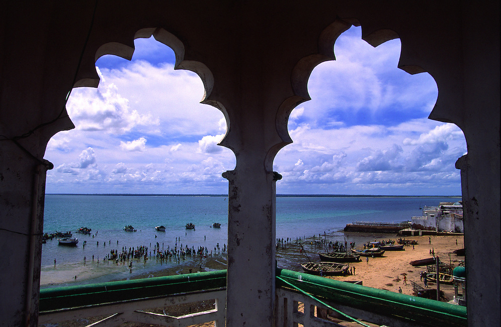 Ilha de Mozambique fishing harbour seen through the windows of the Great Mosque minaret.