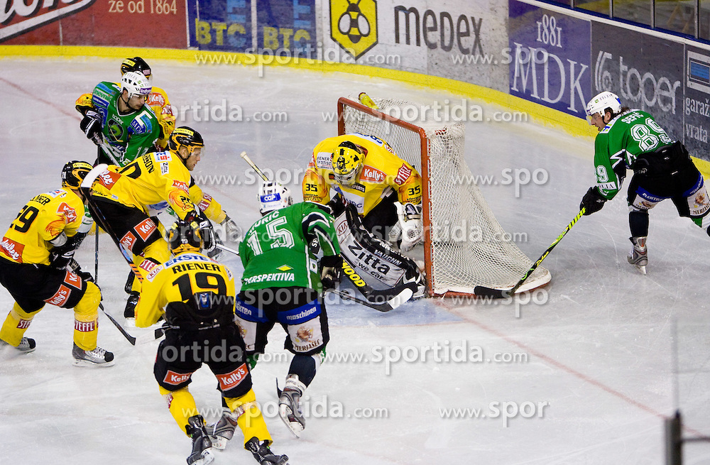 Goalkeeper Frederic Cassivi and David Sefic of Olimpija during 52nd Round of EBEL league ice-hockey match between HDD Tilia Olimpija, Ljubljana and EV Vienna Capitals, on February 7, 2010 in Arena Tivoli, Ljubljana, Slovenia. Vienna defeated Olimpija 8-2. (Photo by Vid Ponikvar / Sportida)