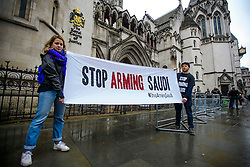 "© Licensed to London News Pictures. 07/02/2017. London, UK. Campaigners hold a banner reading ""STOP ARMING SAUDI""  at the entrance to the Royal Courts of Justice in London, where a the group Campaign Against Arms Trade is challenging the legality of UK arms exports to Saudi Arabia.  Photo credit: Ben Cawthra/LNP"