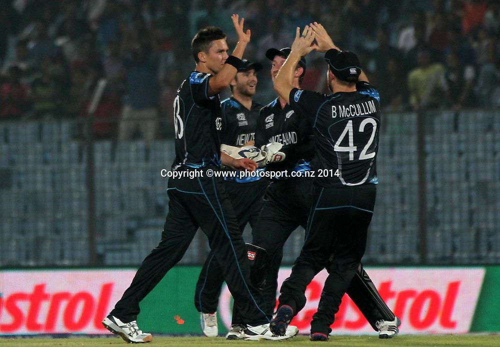 Trent Boult celebrates with team - ICC World Twenty20 cricket, Zahur Ahmed Chowdhury Stadium, Chittagong, Bangladesh. New Zealand v Sri Lanka, 31 March 2014. Photo: www.photosport.co.nz