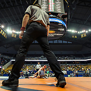 Kris Wilson/News Tribune<br /> Match officials circle the mat as Jefferson City's Tanner Irwin goes for the legs of Park Hill's Carter Goslee in their opening round 132-pound match during the 2016 MSHSAA Wrestling State Championships at Mizzou Arena in Columbia.