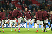 Liverpool players warming up, Liverpool midfielder Jordan Henderson (14) in the centre, before the Champions League match between Bayern Munich and Liverpool at the Allianz Arena, Munich, Germany, on 13 March 2019.