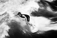 Surfers on the Eisbach River, Munich Germany. September 2006<br /> Photograph Richard Robinson &copy; 2006.
