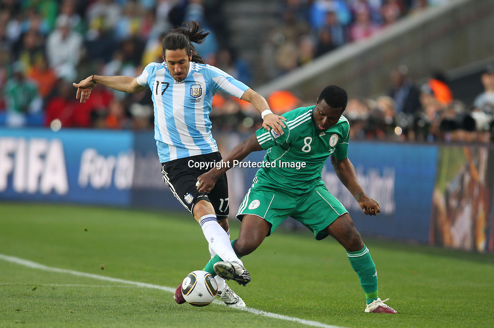 (L-R) Jonas Gutierrez (ARG), Yakubu Ayegbeni (NGR), <br /> JUNE 12, 2010 - Football : <br /> 2010 FIFA World Cup South Africa <br /> Group Match -Group B- <br /> between Argentina 1-0 Nigeria <br /> at Ellis Park Stadium, Johannesburg, South Africa. <br /> (Photo by YUTAKA/AFLO SPORT) [1040]