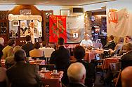 Nederland, Schin op Geul, 20031206.<br /> Pastoor van Schin op Geul in Limburg draagt de mis op. Tijdens de offerande houdt hij de kelken met brood en wijn omhoog. Op de achtergrond een bord met de spreuk: &quot;Heilige Barbara Bid voor ons&quot;.<br /> <br /> Huldiging jubilarissen 2003 van de FNV in HOTEL SALDEN,  te Schin op Geul. <br /> Om 10.00 uur in de ochtend is de aanvang van de Heilige Mis voor de levende en overleden leden van de woonafdeling Groot Valkenburg. De mis is ter ere van St. Barbara, de beschermheilige van de mijnwerkers.<br /> Na de H.Mis Limburgse koffietafel.<br /> <br /> geloof / kerk /