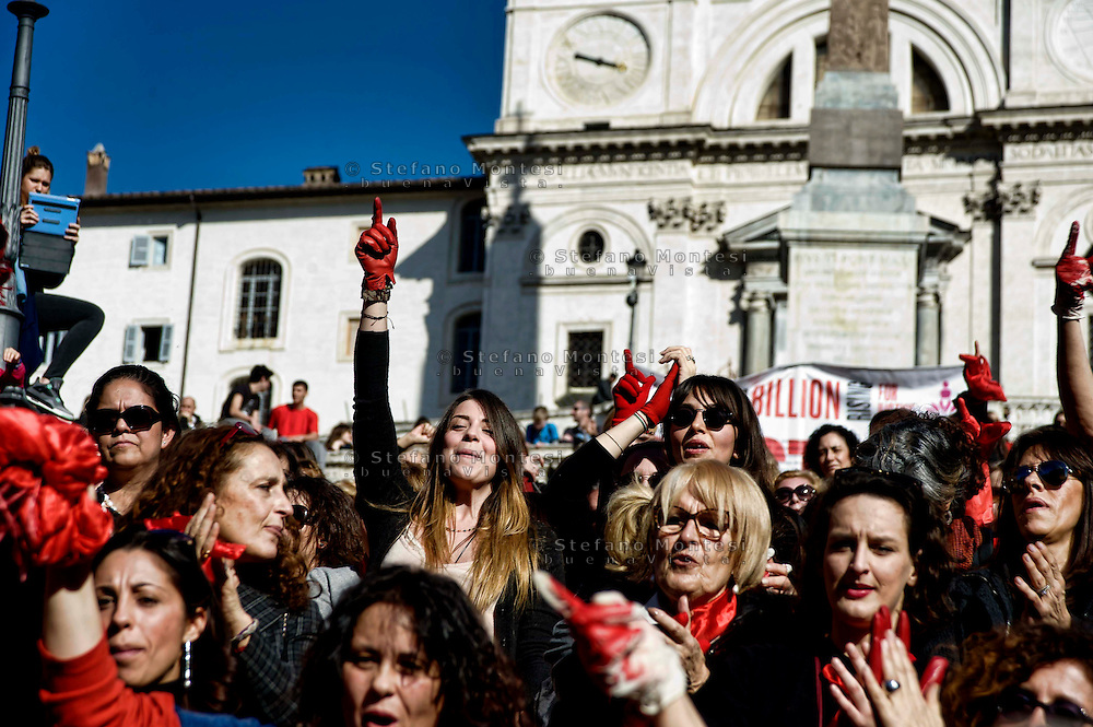 Roma 14 Febbraio 2014<br /> Flash mob mondiale One Billion Rising, Hands off Women, contro la violenza sulle donne, a Trinit&agrave; dei Monti.<br />  One Billion Rising women hold up their hands and a large Italian flag in the rally. -- Participants of the One Billion Rising movement stage a flashmob dance at the piazza Trinit dei Monti in a bid to highlight and call for an end to violence towards women.