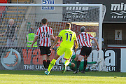 Dillon Phillips fails to stop Andrew Mangan's goal during the Vanarama National League match between Cheltenham Town and Tranmere Rovers at Whaddon Road, Cheltenham, England on 26 September 2015. Photo by Antony Thompson.
