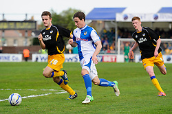 Fabian Broghammer (GER) of Bristol Rovers is challenged by Liam Marsden (ENG) of Mansfield Town - Photo mandatory by-line: Rogan Thomson/JMP - 07966 386802 - 03/05/2014 - SPORT - FOOTBALL - Memorial Stadium, Bristol - Bristol Rovers v Mansfield Town - Sky Bet League Two. (Note: Mansfield are wearing a Rovers spare kit having forgotten their own).
