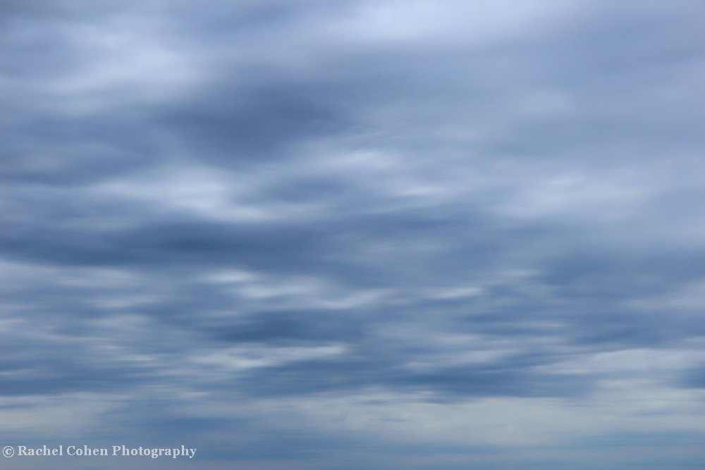 &quot;Flowing Blue&quot;<br /> <br /> Pure lovely flowing blue clouds as they pass quickly above Lake Michigan!!<br /> If your a cloud lover, and a blue lover. Well you may just love this image!!<br /> <br /> Nature Abstracts by Rachel Cohen