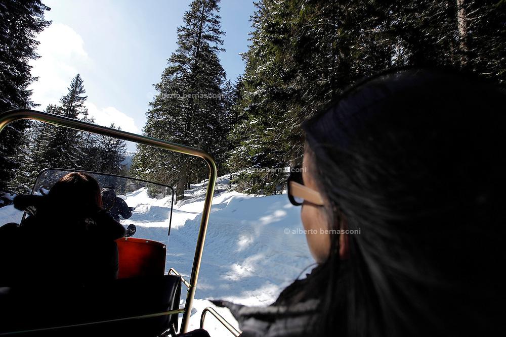 Italy, Madonna di Campiglio, transfer with Gino BRESADOLA's snow scooter to the refuge Malga Ritordo