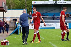 NUNEATON, ENGLAND - Sunday, July 30, 2017:  Liverpool's Conor Masterson shakes hands with Under 23's manager Neil Critchley after he is substituted for Nathaniel Phillips during a pre-season friendly between Liverpool and PSV Eindhoven at the Liberty Way Stadium. (Pic by Paul Greenwood/Propaganda)