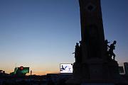 Istanbul. Taksim Square (Taksim Cumhuriyet Meydani). Monuent of the Republic at dusk.