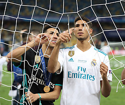 May 26, 2018 - Kiev, Ukraine - Real Madrid's players cut the goal net after winning the UEFA Champions League final football match between Liverpool and Real Madrid at the Olympic Stadium in Kiev, Ukraine on May 26, 2018. Real Madrid defeated Liverpool 3-1. (Credit Image: © Raddad Jebarah/NurPhoto via ZUMA Press)