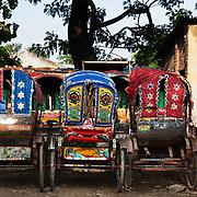 Rickshaws parked up near the Tejgaon train tracks.
