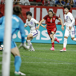 Oct 19, 2017; New Orleans, LA, USA; USA defender Kelly O'Hara (5) works against Korea Republic Cho Sohyun (8) and midfielder Han Chaerin (22) during the first half of an International Friendly Women's Soccer match at the Mercedes-Benz Superdome. Mandatory Credit: Derick E. Hingle-USA TODAY Sports