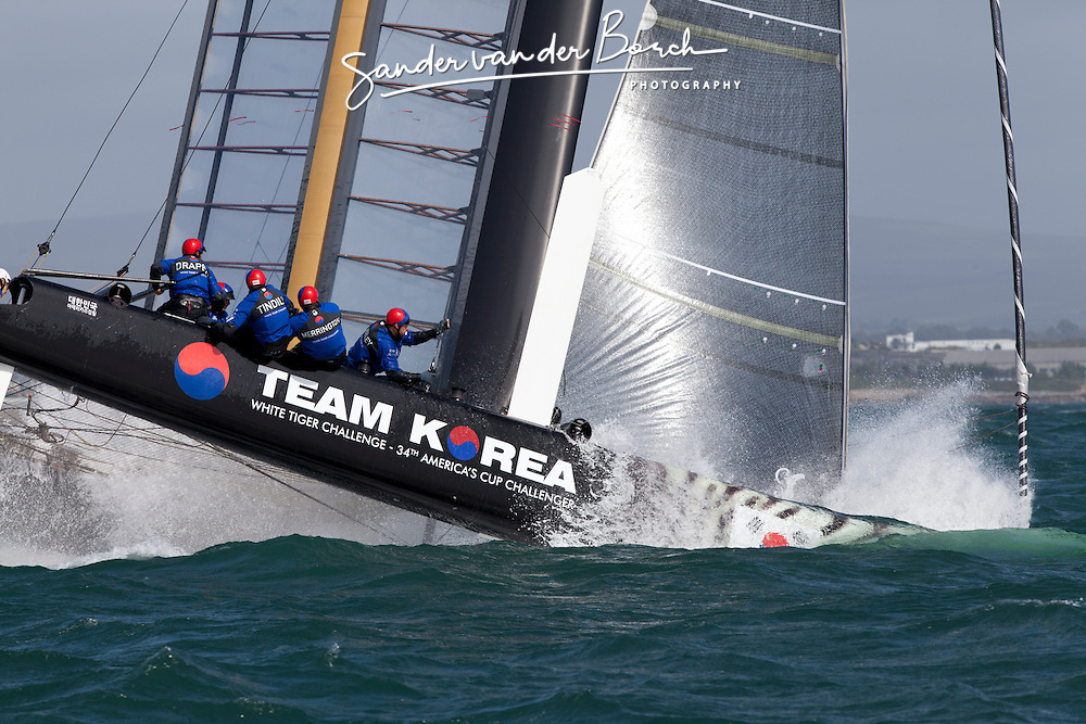 Team Korea capsizing at the top Mark during. September 11th 2011, AC45 World Series Plymouth. Second day of Racing.
