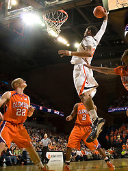 Virginia forward Mike Scott (32) goes up for a one handed dunk against Clemson.  The Virginia Cavaliers defeated the #12 ranked Clemson Tigers in overtime 85-81 at the John Paul Jones Arena on the Grounds of the University of Virginia in Charlottesville, VA on February 15, 2009.