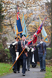 Standard bearers from various veterans associations make their way through Chapeltown Park in Sheffield South Yorkshire up to the War memorial to take part in the  local Remembrance Day service 2011.13 November 2011. Image © Paul David Drabble