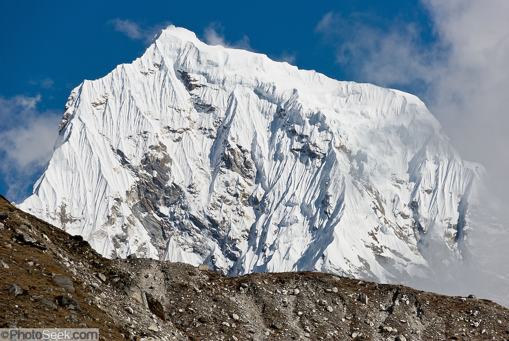 The icy peak of Arakam Tse (21,000 feet), a Himalayan Mountain near Gokyo, Nepal. Sagarmatha National Park was created in 1976 and honored as a UNESCO World Heritage Site in 1979.